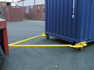 Container on wheels with double tow bars pulled by forklift